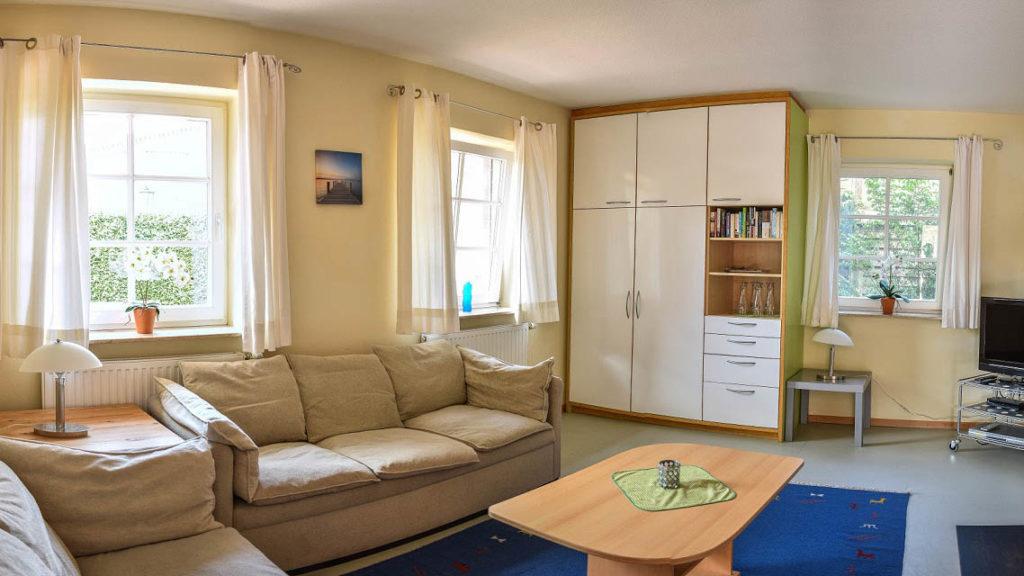 Wohnzimmer zu Zimmer Vier